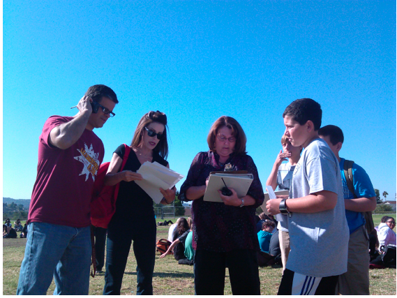 BYMS Disaster Recovery Team collects data during the Great California Shakeout. Featured from left to right are Keith Kish, Sandy Pendelton, Chris McLean and students.