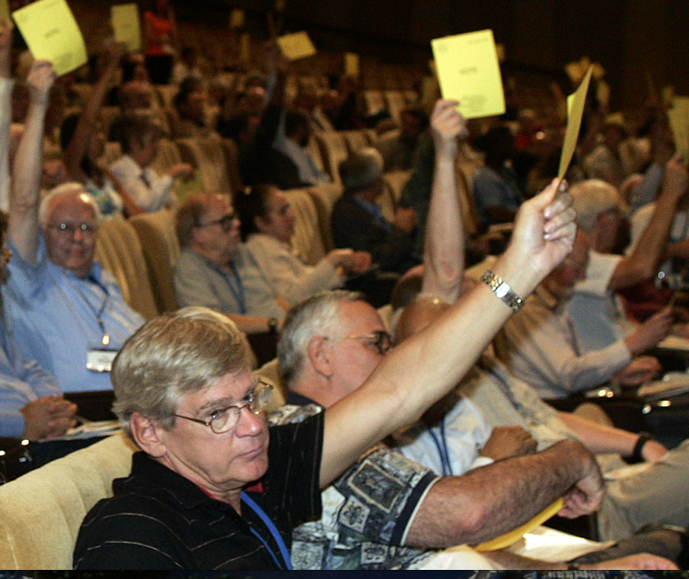 Members of the International Astronomic Union (IAU) vote to reinstate Pluto as a planet. Photo:.theepochtimes.com