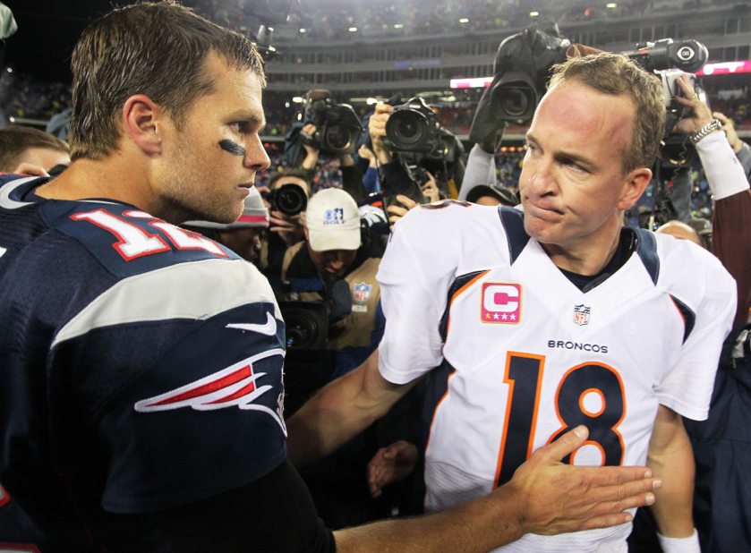 Quarterbacks Tom Brady and Peyton Manning exchange words after game.