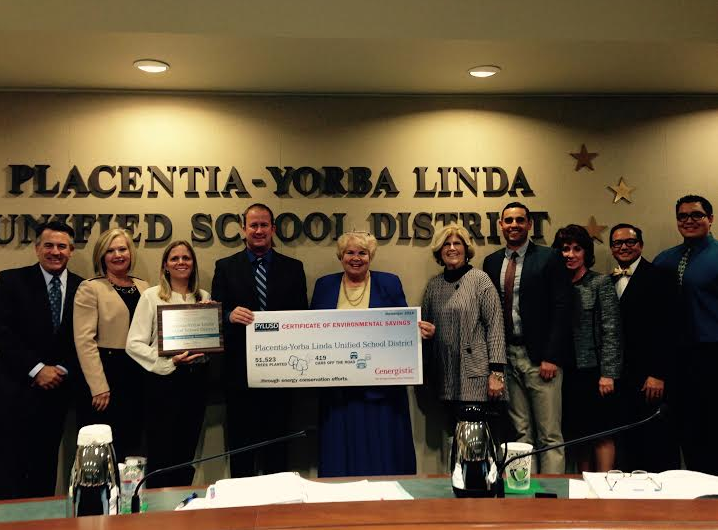 PYLUSD Supt. Dr. Doug Domene, school board members, and district personnel display environmental award.