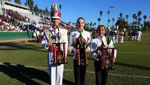 Drum Major,Katharina Abramovich, and Color Guard Captains, Kara Gibbons and Sofia Tinjaca, hold trophies awarded during the Loara Band Review.