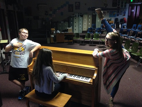 Karson B. on the left, Gabby N. on the piano, and Mackenzie L. on the right