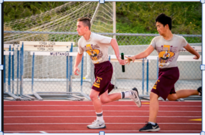 Preston Lin hands off the baton to Aidan Dobyns in winning the R.E.A.C.H Foundation 4x100 relay