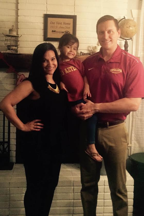 Coach Kevin Oberlander, his wife, Andrea, and his daughter, Amelia