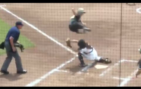 Softball Player Defies Gravity in Play at Home Plate