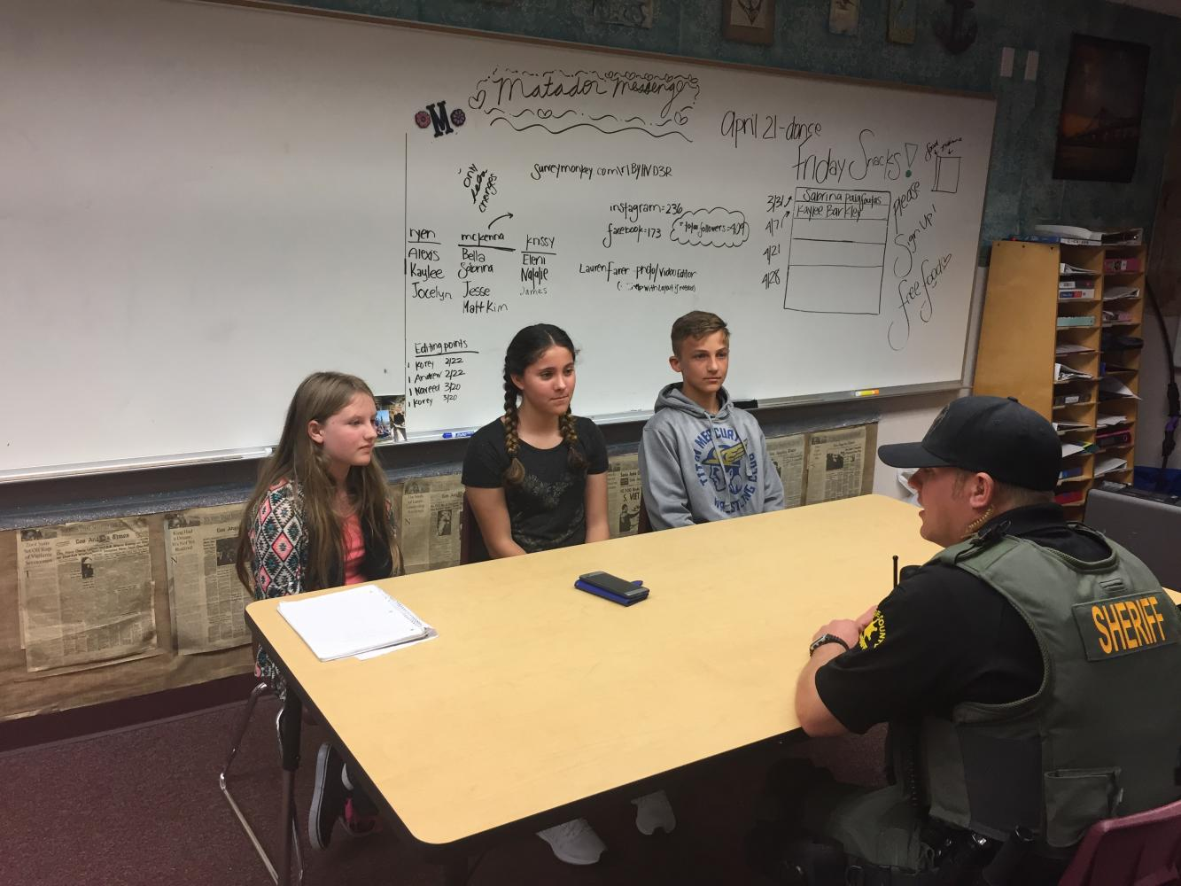 Courtesy of Steven Marshall. BYMS students Elyzabeth Andersen (left), Jocelyn Castaneda (middle),  and Angelo Calavitta (right) speaking with Deputy Nick Doty.