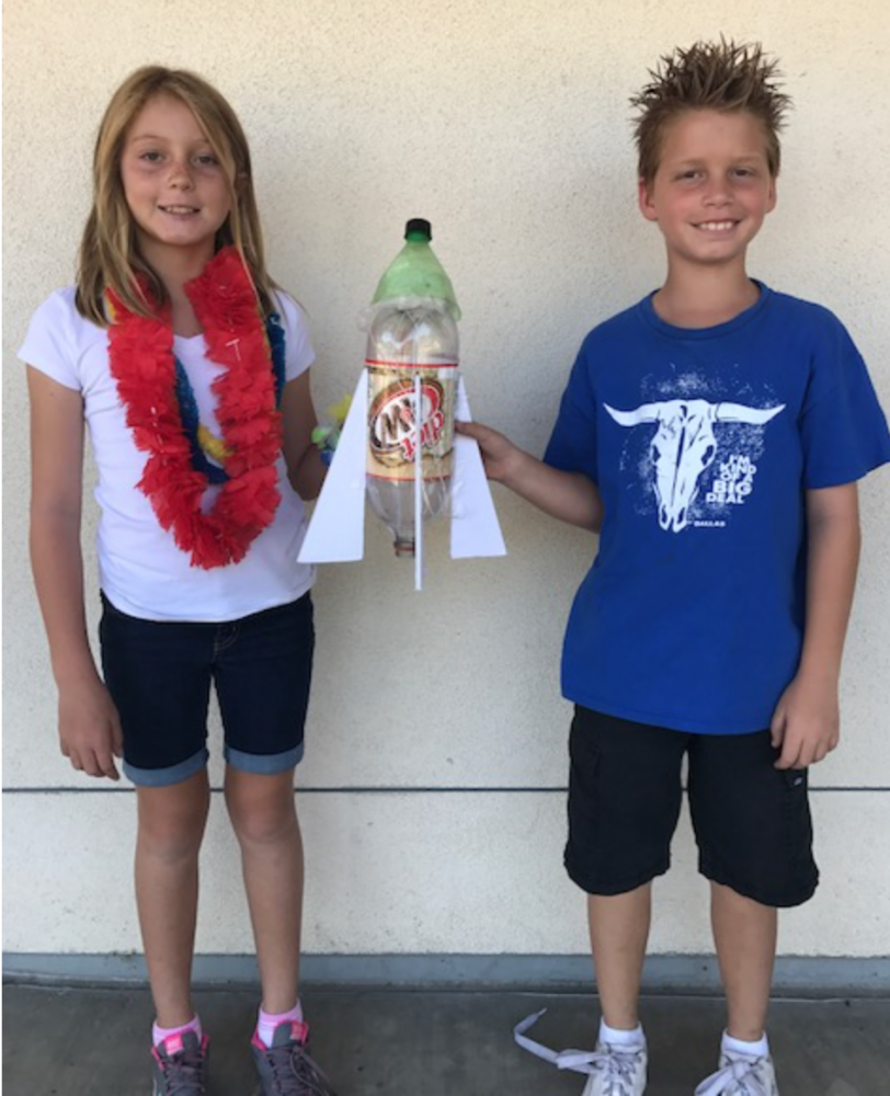 Genevieve Dauphin and Ryder Schawb display bottle rocket created in