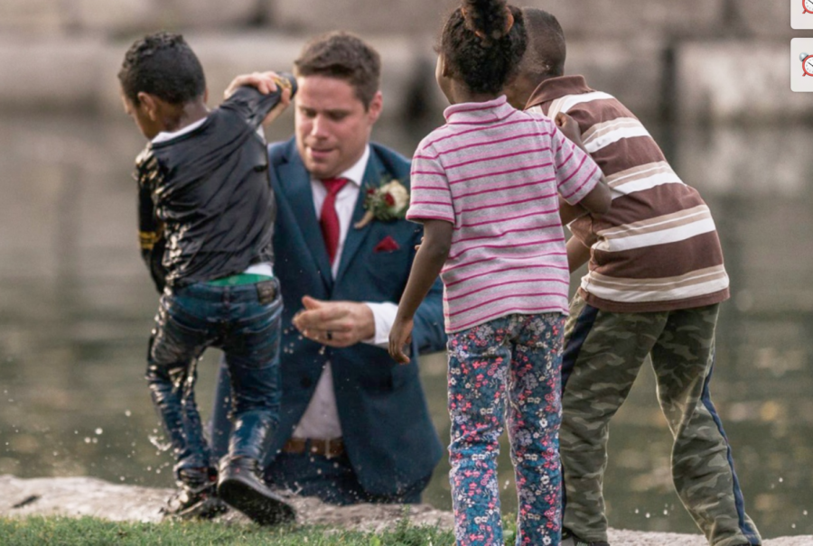 Groom Clayton Cook emerges from pond after saving child from drowning.
