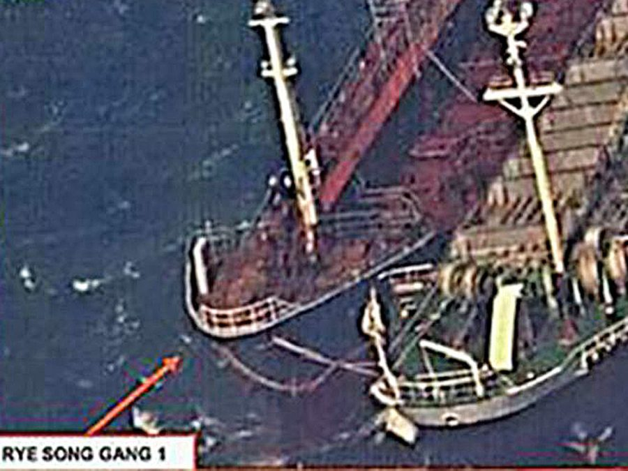 Chinese Ship loads with North Korean coal.