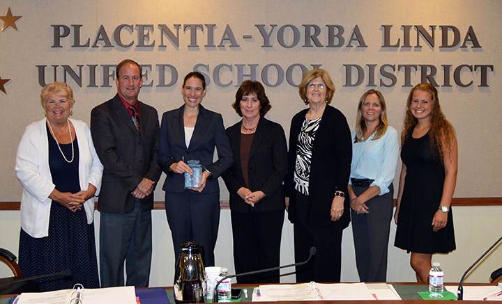 The+Placentia-Yorba+Linda+Unified+School+District+Board+of+Education+presents+the+%22You+Are+The+Advantage%22+award+to+Kim+Mathews%2C+Director+of+Special+Programs+and+Career+Technical+Education+at+Santa+Ana+College.+From+left+to+right%3A+Judi+Carmona%2C+Eric+Padget%2C+Kim+Mathews%2C+Karin+Freeman%2C+Carol+Downey%2C+Carrie+Buck+and+Emily+Drinkwine.