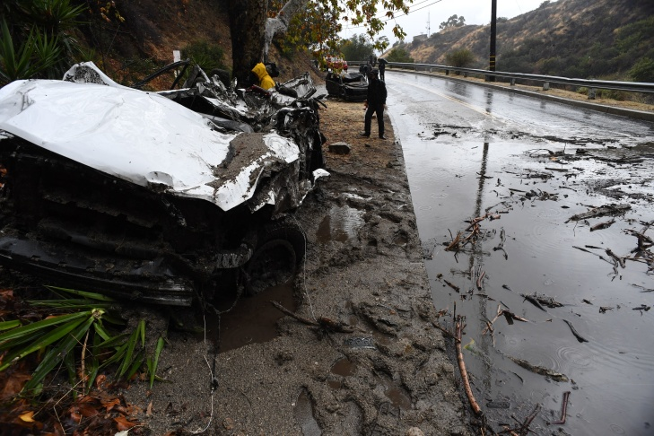 Mud fills a street after a rain-driven mudslide destroyed two cars and damaged property.
