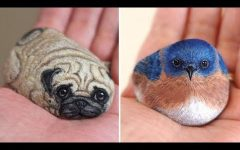 Japanese Artist Transforms River Stones into Palm Sized Animals