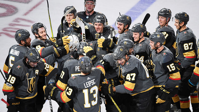 Oct 17, 2017; Las Vegas, NV, USA; Vegas Golden Knights players celebrate around  left wing David Perron (57) after he scored a game-winning goal in overtime against the Buffalo Sabres at T-Mobile Arena. Mandatory Credit: Stephen R. Sylvanie-USA TODAY Sports
