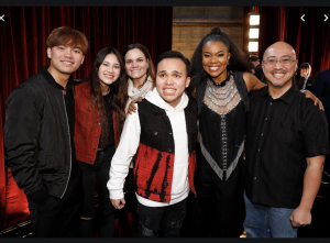 Lee is pictured with family and AGT judge, Gabrielle Union, who had awarded Lee the