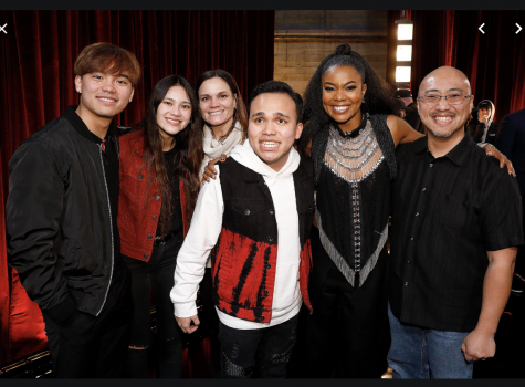 "Lee is pictured with family and AGT judge, Gabrielle Union, who had awarded Lee the ""Golden Buzzer"" during the season."