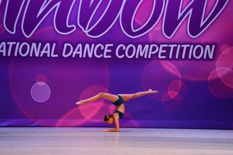 Kam preforming one of her routines in a competition